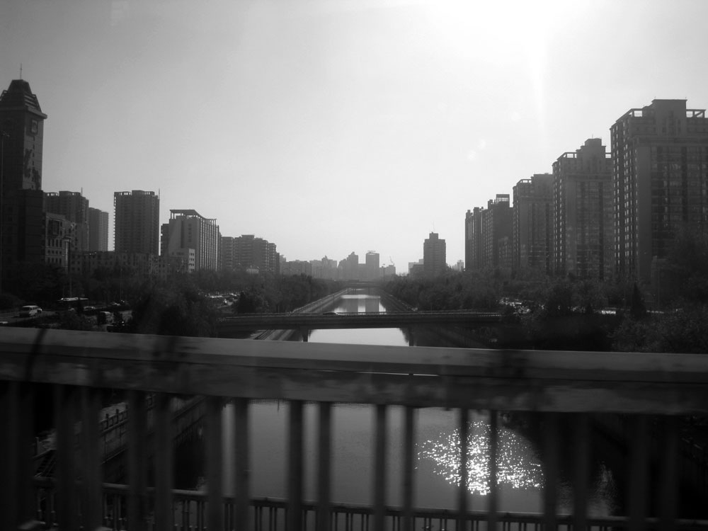 Canal with buildings on either side in Beijing China