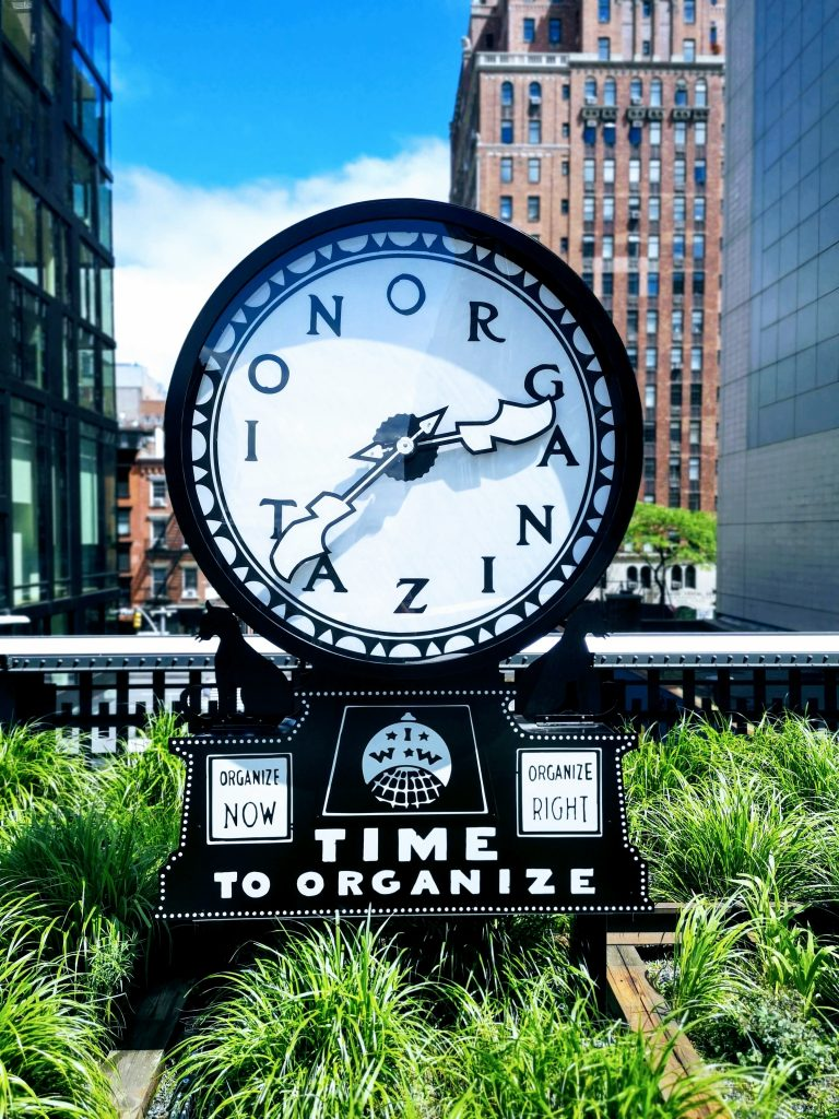 A clock that says 'time to organize'