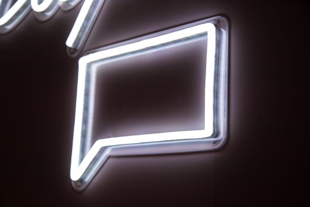 Neon sign of a chat box