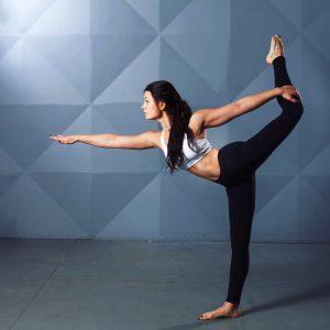 Women striking a yoga pose.